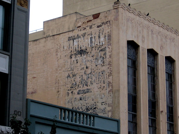 Faded sign on side of a building on the 900 block of Fifth Avenue.