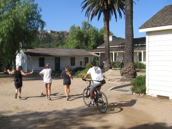 Jogging and biking past the historic adobe ranch house in Los Peñasquitos Canyon Preserve.
