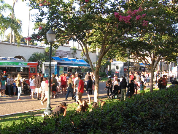 People stroll down El Prado, checking out a variety of gourmet food trucks on a late Friday afternoon.