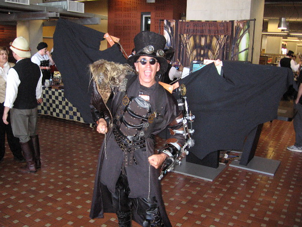 A guy with a super cool steampunk outfit spread his mechanical wings for a photo as I entered the library!
