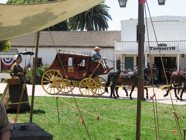 A Wells Fargo stagecoach takes a turn around La Plaza de Las Armas in San Diego's historic Old Town.