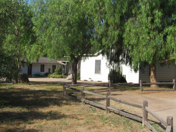 The ranch house is nestled among some shady trees. Two small adobe buildings were originally built in 1823. The house was enlarged by Captain George Alonzo Johnson in 1862.
