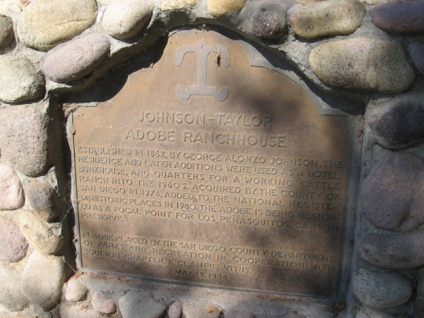 Plaque describes the establishment of the Johnson-Taylor Adobe Ranchhouse in 1862. The residence and later additions were used as a hotel, bunkhouse, and quarters for a working cattle ranch into the 1960s.