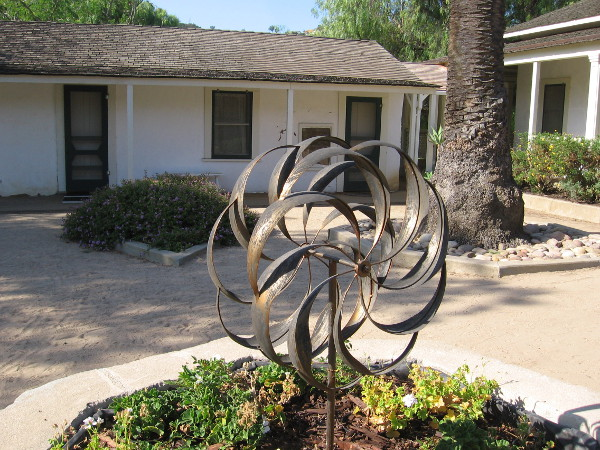 A sculpture inside the courtyard, located on the east side (rear) of the ranch house. The planters were probably used to grow herbs and flowers.