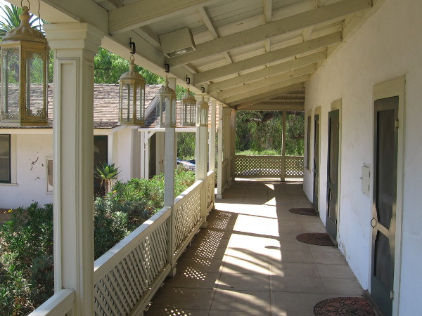 Part of the ranch house's long porch beside the courtyard.