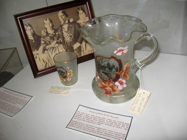 A hand blown and painted glass pitcher and drinking glass that belonged to Maria de Jesus Alvarado de Sepulveda, daughter of Francisco María Alvarado.