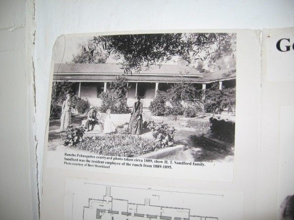 Rancho Peñasquitos courtyard photo taken circa 1889, showing ranch employee H. T. Sandford and his family.