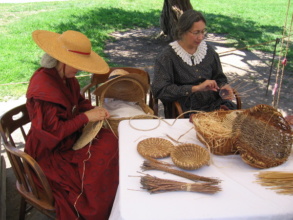 These ladies were weaving baskets. Basket-weaving is said to be the oldest of all human crafts.