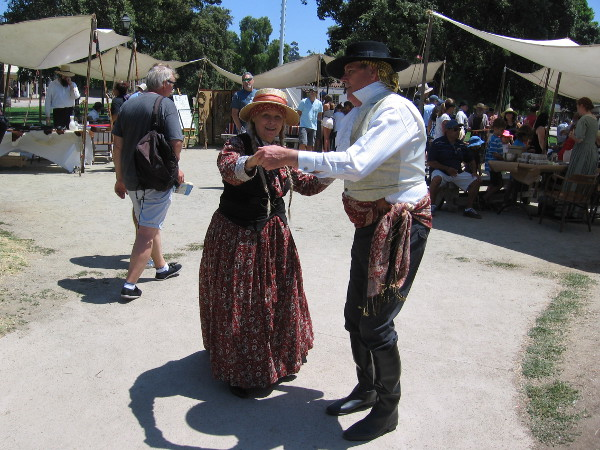A couple dances to the happy, gentle music.