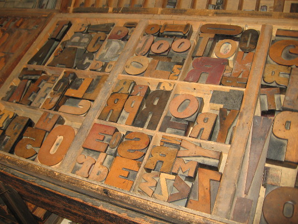 A type case full of large cast metal sorts. Individual letters were combined into words, sentences and paragraphs.