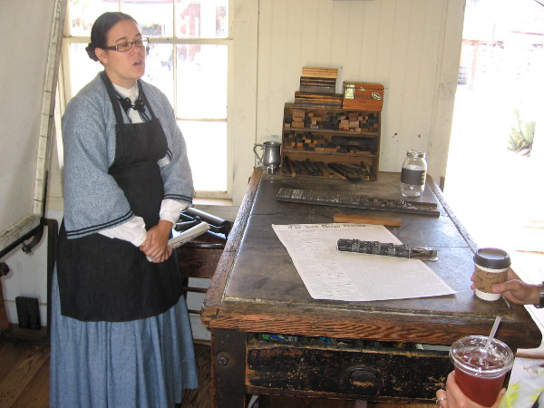 A docent explains how the San Diego Union newspaper was composed and printed many years ago.
