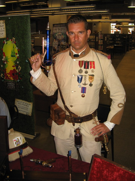 Richard Ferrell aka Colonel Malcolm Weatherby was holding a ray gun at the ready. Like many other steampunk enthusiasts, he makes his own props.
