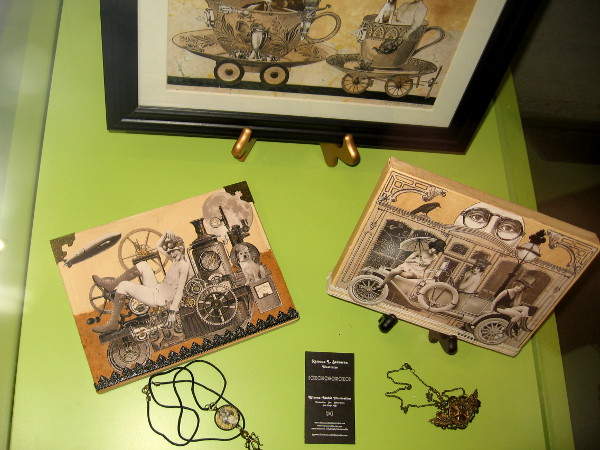 In a glass library display case I discovered steampunk collage art by Ramona Szczerba. She calls these curious vintage fictions.