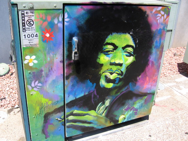 Cool street art in East Village shows a colorful Jimi Hendrix.