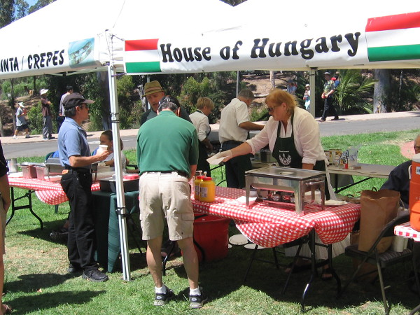 Hungarian sausage and crepes were being prepared at one end of the lawn!