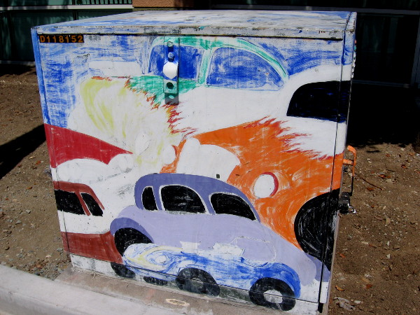 Street art shows colorful cars.