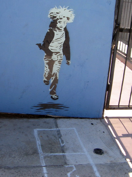 Graffiti child on a wall ready to play hopscotch at Coin Haus.
