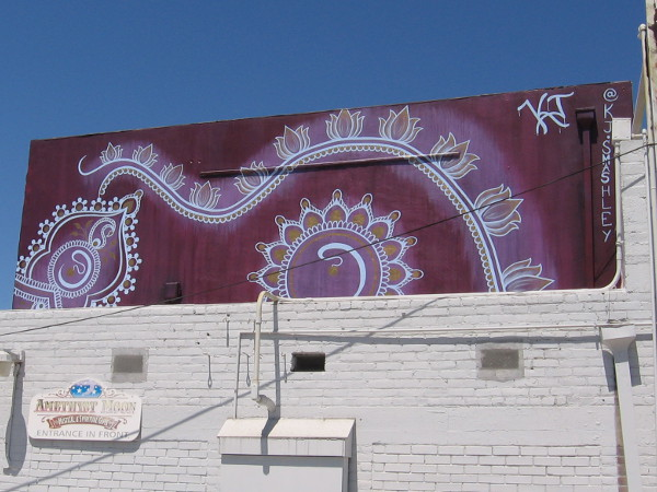 Exotic mural up high in the alley behind Amethyst Moon.
