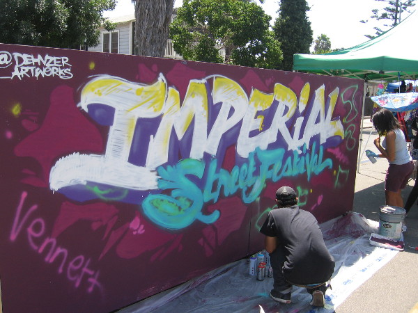 Anyone could add their own creative touch to this cool Imperial Street Festival spray paint mural!