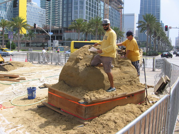 These local sand artists belong to the I.B. Posse. They're working on a sculpture for MTS that will include San Diego's skyline.