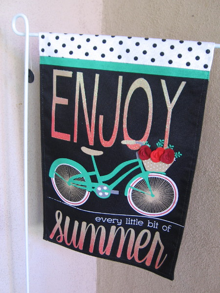 A banner by door to the Balboa Park Visitors Center. Enjoy every little bit of summer.