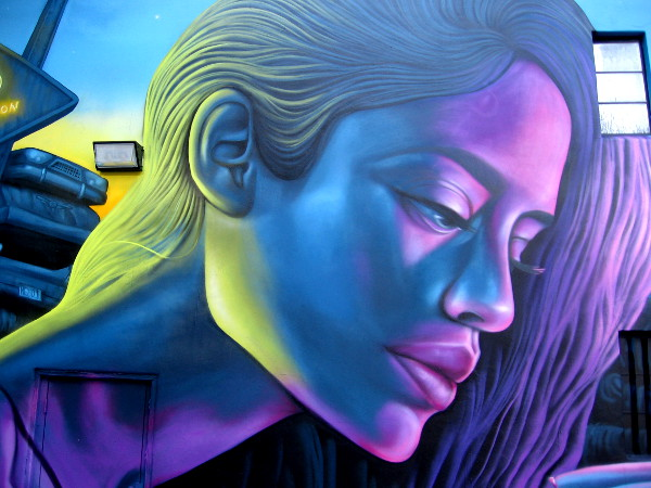 A beautiful female face has materialized on a building wall in downtown San Diego!