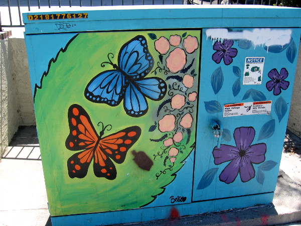 Butterflies and flowers brighten a La Mesa sidewalk.