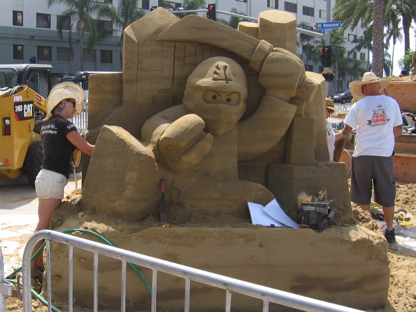 Melineige Beauregard, a champion sand sculptor from Quebec, is working on this super cool LEGO Ninjago piece!