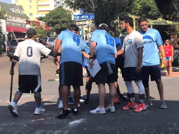 Tampa Chargers huddle up during the 2017 Labor Day Stickball Tournament in Little Italy. Photo by Margie Jones.