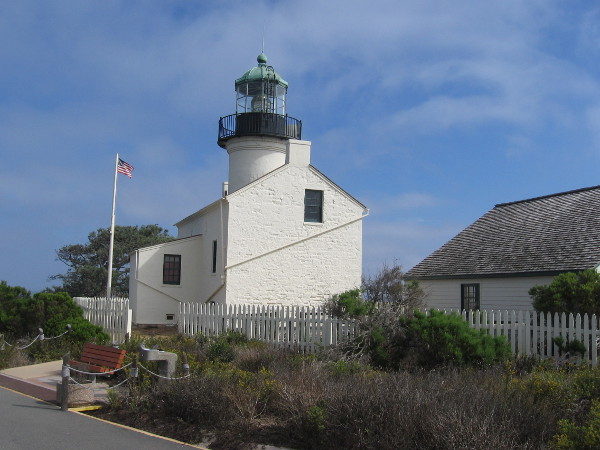 The beautiful Old Point Loma Lighthouse and the nearby Assistant Keepers Quarters building at Cabrillo National Monument.