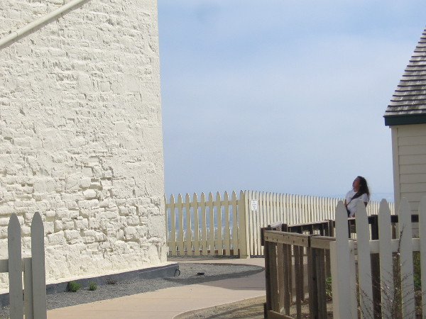 Visitor to Cabrillo National Monument looks up at the lighthouse.