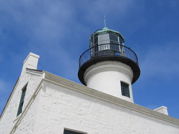 Built in 1855 at the end of the Point Loma peninsula, above the entrance to San Diego Bay, the old lighthouse used to guide sailors to safety with a powerful fresnel lens.