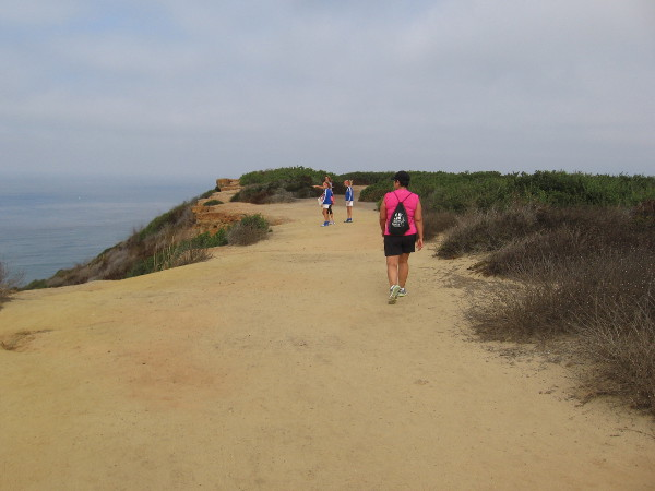 Walking along the cliffside trail north of the lighthouse.