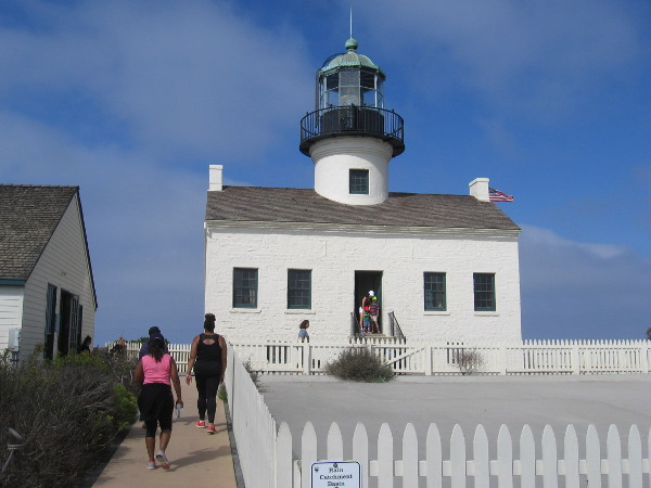 Photo of Old Point Loma Lighthouse, the small museum beside it and the large Rain Catchment Basin.