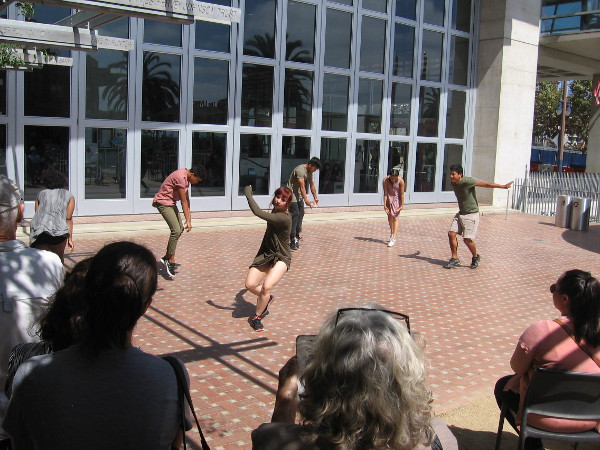 The dancers come outside and engage the audience.