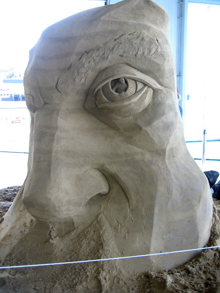 World Master sand sculptor Dan Belcher from St. Louis, Missouri is creating a large, fantastic face.