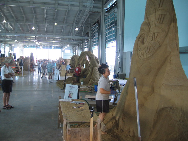 Sue McGrew of Tacoma, Washington works on some monumental sand art that represents the continuum of time.