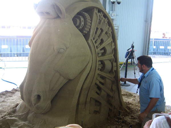 Rusty Croft from Carmel, California is carving an amazing horse's head made of sand.