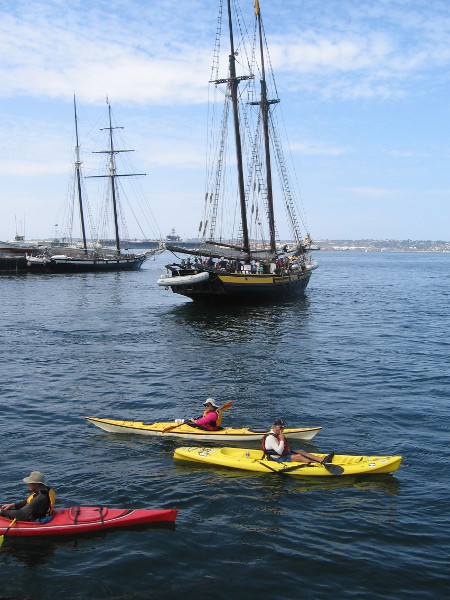 People on kayaks enjoy the seafaring festival and the many tall ships that have converged in San Diego for the Labor Day weekend.