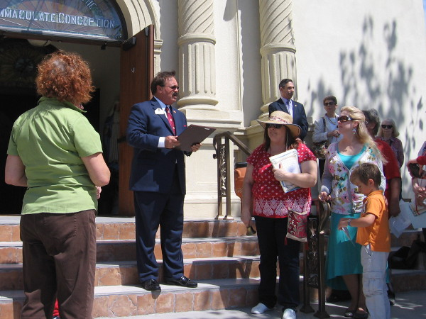 Fred Grand, President of the Old Town Chamber of Commerce, reads a proclamation during a special Constitution Day ceremony.