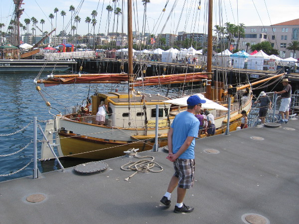 Someone walks along near the Norwegian double ended ketch Cloudia.