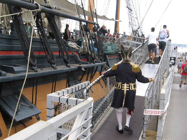 An admiral boards HMS Surprise. Many colorful costumes and period attire can be seen every year at the Festival of Sail.