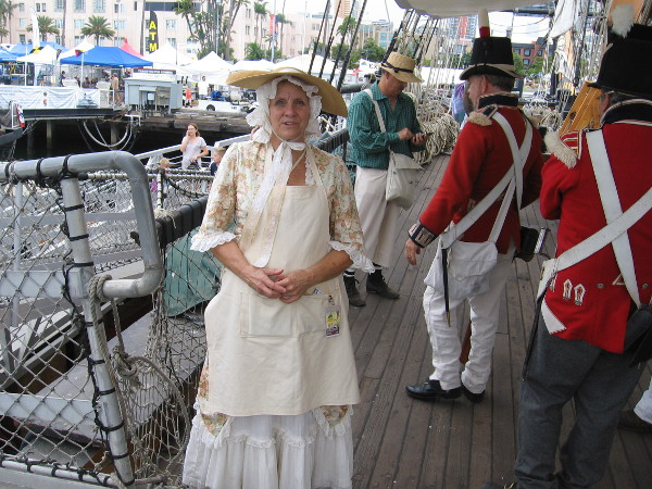 This lady is dressed as a warrant officer's wife. I learned wives of officers often lived aboard British Royal Navy ships in the early 19th century.