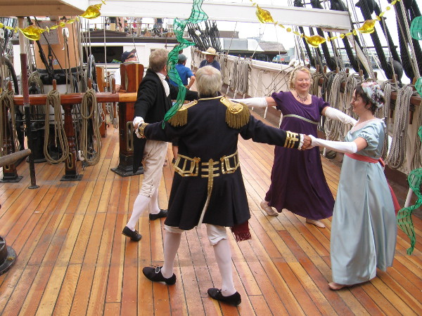 Performers on the Star of India demonstrate dancing that would have been common in 1805, when the Royal Navy beat France and Spain at the Battle of Trafalgar.