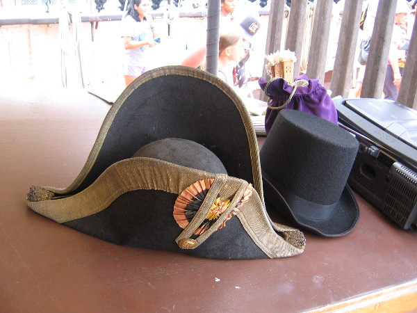 19th century hats lie at the ready near a CD player!