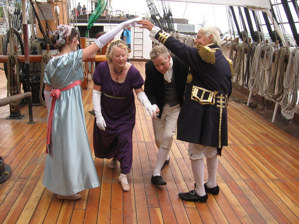 The admiral and three others in a dance typical of the period.