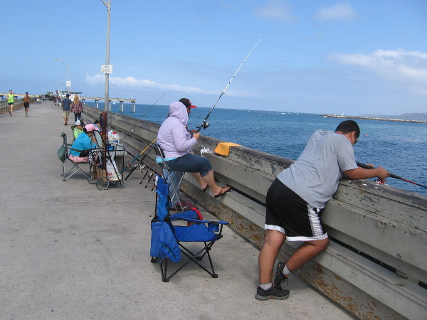 Fishermen enjoy a perfect September day along the Ocean Beach Pier. Today everybody was catching mackerel.