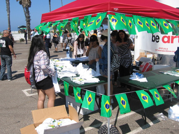 Lots of Brazilian flags at this t-shirt booth.