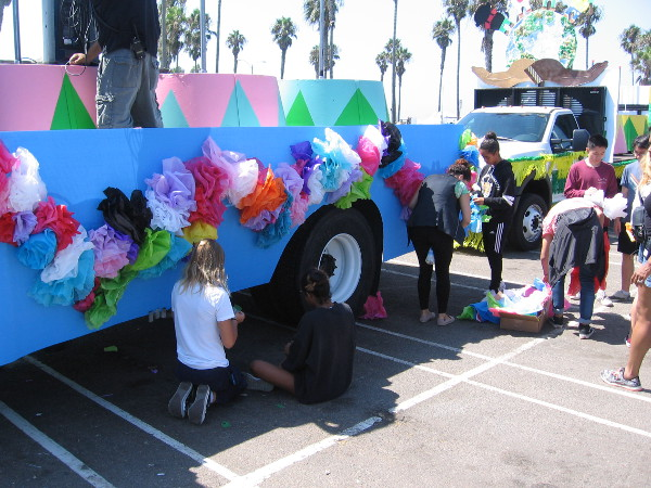 Later in the afternoon there would be a carnival-like parade around Belmont Park, and some people were decorating a colorful float.