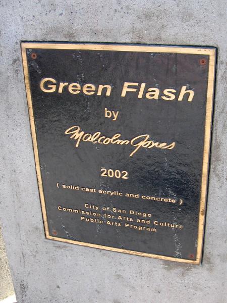 A plaque describes the unusual public artwork. Green Flash by Malcolm Jones, 2002. Solid cast acrylic and concrete.
